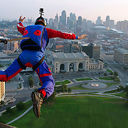 Major Alastair Macartney, an officer in the British Army and a BASE jumping world champion, lept off the 217-foot-high observation deck of the Liberty Memorial at the National World War I Museum in Kansas City, Mo. on Monday morning. Macartney performed the jump in commemoration of the upcoming centennial of the memorial and he will speak about his experiences at TEDxKC on Tuesday at the Kauffman Center for the Performing Arts.