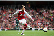 Aaron Ramsey Of Arsenal  crosses the ball .<br /> Premier league match, Arsenal v Brighton & Hove Albion at the Emirates Stadium in London on Sunday 1st October 2017. pic by Kieran Clarke, Andrew Orchard sports photography.
