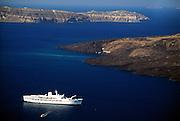 Greece, Cyclades, island of Santorini, cruise ship in sea.