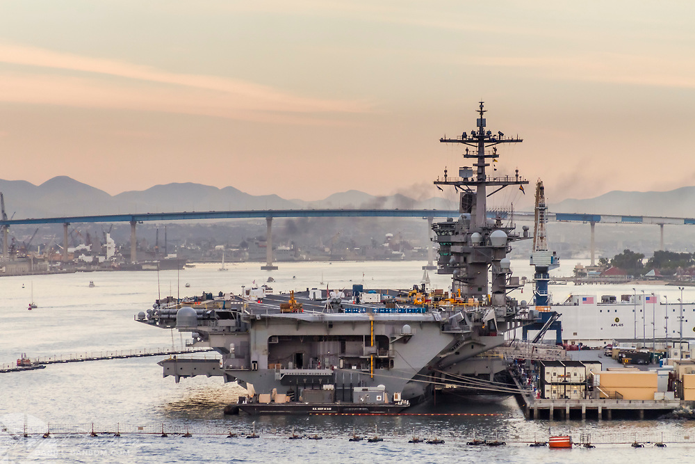 Leaving port in San Diego, California, view of aircraft carrier in port for service.