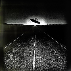 UFO on road at night with dawn on the horizon vintage Roswell style monochrome grainy image with film surround