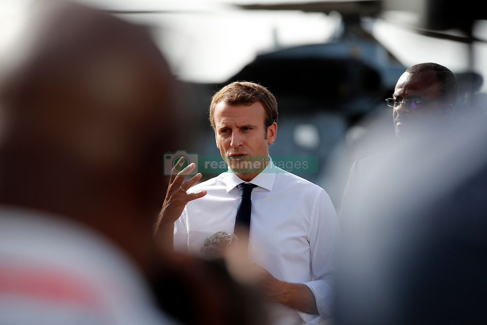 France's President Emmanuel Macron addresses the media upon his arrival in Pointe-a-Pitre, Guadeloupe island, the first step of his visit to French Caribbean islands, Tuesday, Sept. 12, 2017. Photo by Christophe Ena/Pool/ABACAPRESS.COM