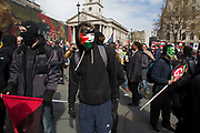 Anarchists at the Peoples Assembly Against Austerity demonstration against cuts for health, homes, jobs and education onSaturday April 16th in London, United Kingdom. Tens of thousands of people gathered to protest in a march through the capital protesting against the Conservative Party cuts. Almost 150Councillors fromacross the countryhave signed a letter criticising the Government for funding cuts and and will be joining those marching in London. The letter followed the recent budget in which the Government laid out plans to cut support for disabled people while offering tax breaks for big business and the wealthy.