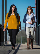 Victoria Salinas, left, and Nataly Degollado, right, pose for a photograph outside of the college success center at Austin High School, January 23, 2017.