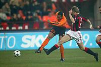 Milano, 14/01/2004Gara di andata dei quarti di finale di Coppa Italia Milan-AS Roma<br /> A shot of Carew challenged by Laursen<br /> Foto Graffiti