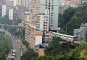 CHONGQING, CHINA - JULY 31: (CHINA OUT) <br /> <br /> Light Rail Pass Through Building <br /> <br /> A light rail passes through a building on July 31, 2014 in Chongqing, China. The complex landform of Chongqing brings up the unique scene of Chongqing's light rail passing through a building. <br /> ©Exclusivepix