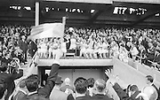 Presentation of cup to Offaly Captain after the All Ireland Minor Gaelic Football final Cork V. Offaly in Croke Park on 27th September 1964.