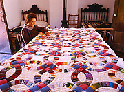 Living History Park Ranger Yvonne Heaton working on Double Wedding Ring Quilt, Winsor Castle, Pipe Spring National Monument, Arizona.