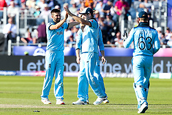 Mark Wood of England celebrates with teammates after taking the wicket of Matt Henry of New Zealand - Mandatory by-line: Robbie Stephenson/JMP - 03/07/2019 - CRICKET - Emirates Riverside - Chester-le-Street, England - England v New Zealand - ICC Cricket World Cup 2019 - Group Stage