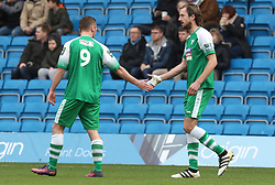 Leatherhead's Jack Midson (right) is congratulated by Niall McManus after scoring the opening goal during the Emirates FA Cup, second round match at Adams Park, Wycombe.