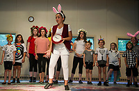 The White Rabbit (Carlee Farwell) is late as the cast and crew take the stage at the Gilford Methodist Church in Gilford for dress rehearsal for Alice in Wonderland with SKYT (Streetcar Kids Youth Theater) Monday evening.  (Karen Bobotas/for the Laconia Daily Sun)