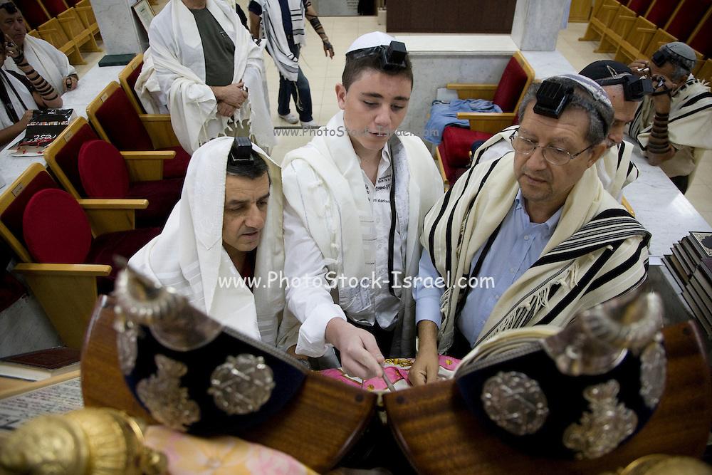 Israel, Tel Aviv, Beit Daniel, Tel Aviv's first Reform Synagogue Bar Mitzvah ceremony. Bar Mitzvah boy reads from the Torah