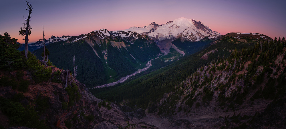 Mount Rainier glows in the morning twilight, looking up the White River valley to Emmon's Glacier.