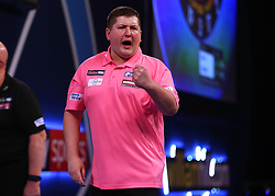Keegan Brown celebrates winning his match against Karel Sedlacek during day three of the William Hill World Darts Championships at Alexandra Palace, London.