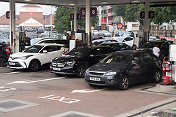 © Licensed to London News Pictures. 26/09/2021. London, UK. Motorists fill their vehicles with fuel at a Sainsbury's petrol station in Alperton, West London as it reopens. There has been problems with the supply and distribution chain. Companies including BP and Shell have restricted deliveries due to the lack of HGV drivers. Photo credit: London News Pictures
