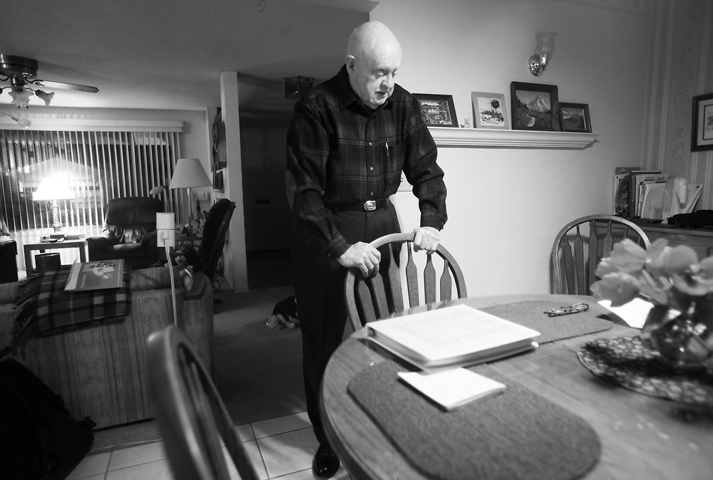 Ivan Mahoney and his wife, Dot , look through the first of many scrapbooks Dot made long ago that tell the story of their courtship, marriage and more than 60 years of life together. Due to the ravages of Alzheimer's Disease, Dot no longer remembers making the scrapbooks and rarely recognizes the facts of the story or the faces in the photographs. Wednesday, Nov. 10, 2010.
