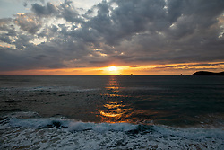 ©2020 Tom Nicholson. 10/05/2020. Padstow, UK. The sun sets on Constantine Bay beach, Cornwall, on the evening British Prime Minister Boris Johnson announced a 'road map' to begin the end of lockdown due after Covid-19, (Coronavirus). Photo credit : Tom Nicholson
