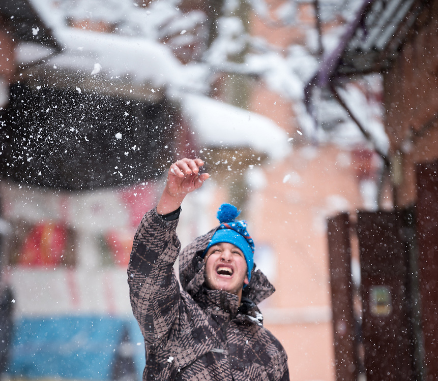 7 January 2018, Imlil, Morocco: Mustafa works in a small souvenir shop in the village of Imlil, near Mount Tubkal in the Moroccan Atlas mountains. With the arrival of the first precipitation in a month's time, he takes time to enjoy a moment in the snow. Although heavy snowfall means heavy work for the villagers in cleaning up rooftops and roads, it is also a welcome contribution, as the snow helps attract tourists to the area, as well as secure water supplies to local agriculture.
