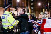 January 31, 2020, London, England, United Kingdom: A Brexit supporter shouting racist remarks towards a Police Officer nearby Downing Street entrance in London on Jan. 31, 2020. (Photo/Vudi Xhymshiti).Home Office figures show there was a sharp increase in racially and religiously motivated hate crime around the 2016 EU referendum. The number of racially and religiously motivated hate crimes was 44% higher than in July 2015 of the previous year. (Credit Image: © Vedat Xhymshiti/ZUMA Wire)