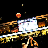 031413  Adron Gardner/Independent<br /> <br /> Shiprock Chieftain Jeremiah Johnson (40) fires a shot over a Hope Christian Husky under the jumbo monitor at The Pit in the 3A boys semifinal in Albuquerque Friday.