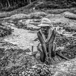 Fea0093883. DT News.Tananarive a mining village near AMBATONDRAZAKA,The Ankeniheny-Zahamena Corridor, Madagascar.Pic Shows A lady looking for sapphires in the village of Tananarive