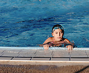 Young girl of 8 in a swimming pool