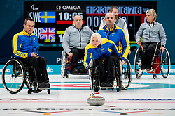March 12, 2018 - Pyeongchang, SOUTH KOREA - 180312 Ronny Persson, Kristina Ulander and Mats-Ola Engborg of Sweden during the wheelchair curling mixed round robin session between Sweden and Great Britain during day three of the 2018 Winter Paralympics on March 12, 2018 in Pyeongchang. (Credit Image: © Vegard Wivestad Grott/Bildbyran via ZUMA Press)