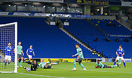 Brighton and Hove Albion forward Neal Maupay (9) shoots with Everton goalkeeper Robin Olsen (33) saving during the Premier League match between Brighton and Hove Albion and Everton at the American Express Community Stadium, Brighton and Hove, England UK on 12 April 2021.