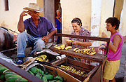 23 JULY 2002 - TRINIDAD, SANCTI SPIRITUS, CUBA: A door to door fruit seller does business in the colonial city of Trinidad, province of Sancti Spiritus, Cuba, July 23, 2002. Trinidad is one of the oldest cities in Cuba and was founded in 1514. .PHOTO BY JACK KURTZ