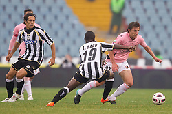 Emmanuel Agyemang Badu of Udinese vs Armin Bacinovic of Palermo during football match between Udinese Calcio and Palermo in 8th Round of Italian Seria A league, on October 24, 2010 at Stadium Friuli, Udine, Italy.  Udinese defeated Palermo 2 - 1. (Photo By Vid Ponikvar / Sportida.com)
