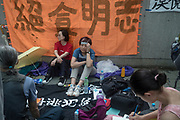 Minnie Li (in blue), a Chinese citizen from Shanghai, does a hunger strike as she faces riot police during a mass protest near the Central Government Offices, during a protest against a proposed extradition law in Hong Kong, SAR China, on Wednesday, June 12, 2019. Hong Kong's legislative chief postponed the debate on legislation that would allow extraditions to China after thousands of protesters converged outside the chamber demanding the government to withdraw the bill. Photo by Suzanne Lee/PANOS
