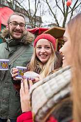Friends with mulled wine at Christmas market