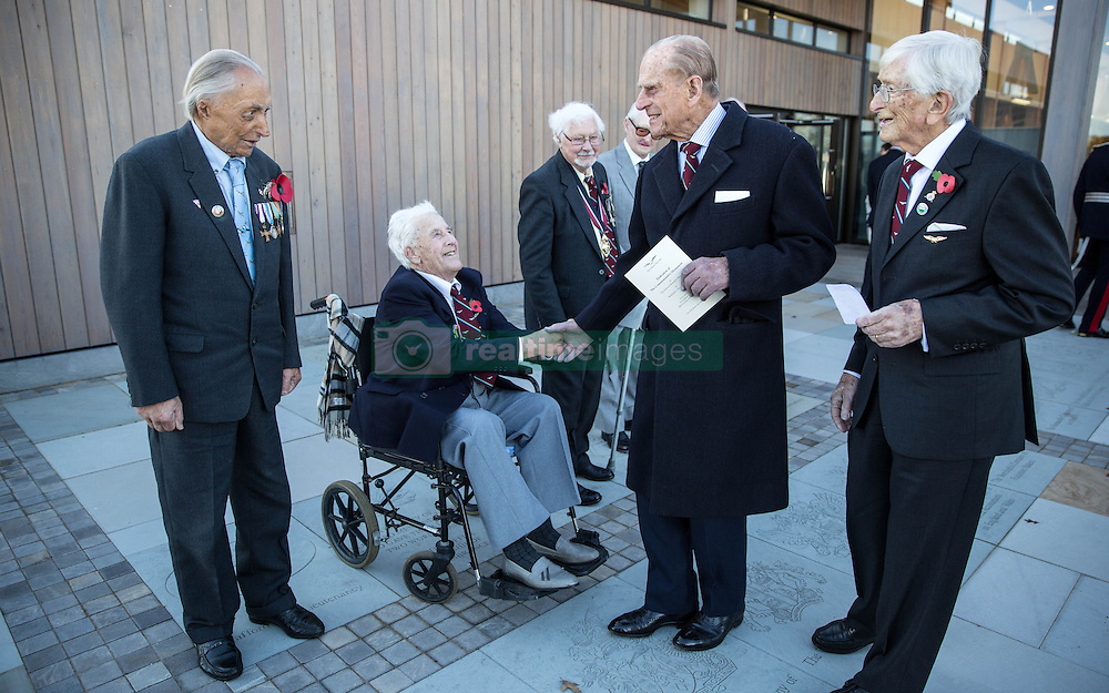 """The Duke of Edinburgh (2nd right) meets Surviving """"Guinea pig club"""" member Alan Morgan (in wheel chair) and Polish fighter pilot Jan Stanrycruk after he unveiled a memorial to them at the National Memorial Arboretum, Staffordshire."""