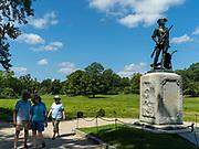 Tourist view the Minute Man Statute, Minute Man National Historic Site, Concord, Massachusetts, USA.