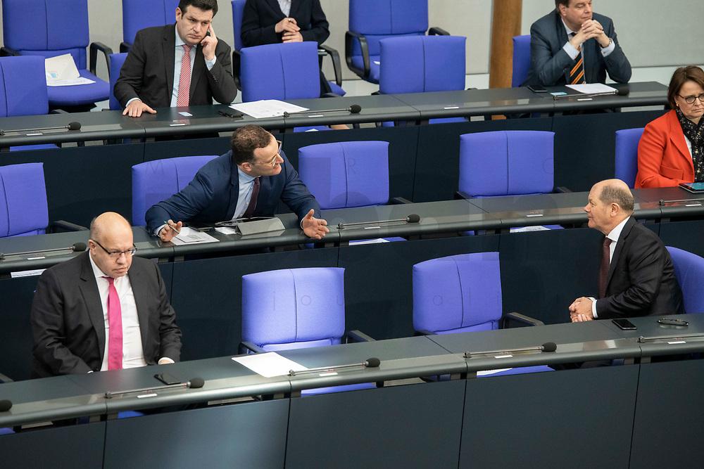 """25 MAR 2020, BERLIN/GERMANY:<br /> Peter Altmaier (L), CDU, Bundeswirtschaftsminister, Jens Spahn (M), CDU, Bundesgesundheitsminister, und Olaf Scholz (R), SPD, Bundesfinanzminister, im Gespraech. Um das Abstandsgebot zu beachten, ist nur jder dritte Platz in den Abgeordnentenreihen besetzt, Bundestagsdebatte zu """"COVID 19 - Kreditobergrenzen, Nachtragshaushalt, Wirtschaftsfonds"""", Plenum, Reichstagsgebaeude, Deutscher Bundestag<br /> IMAGE: 20200325-01-026<br /> KEYWORDS: Pandemie, Corona, Sitzung, Debatte, Gespräch"""