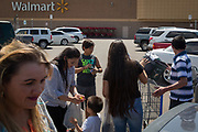 Orfa (second from L), a Honduran migrant seeking asylum, finishes a shopping trip to Walmart with her family in Clovis, New Mexico, U.S., June 12, 2018.