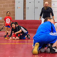 021015       Cable Hoover<br /> <br /> Coach Nate Sellers gives instructions to a group of young wrestlers during Stars and Stripes wrestling club practice at Miyamura High School Tuesday. Sellers said about 25 of the clubs wrestlers would compete in the Amatuer Athletic Union state wrestling tournament in Albuquerque this weekend.