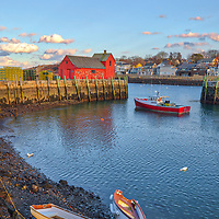 New England photography of the famous red fishing shack Motif #1 in Rockport, MA on Cape Ann at sunset. The historic landmark is known throughout New England as Motif #1, so called because it is the most often painted building in America.<br />