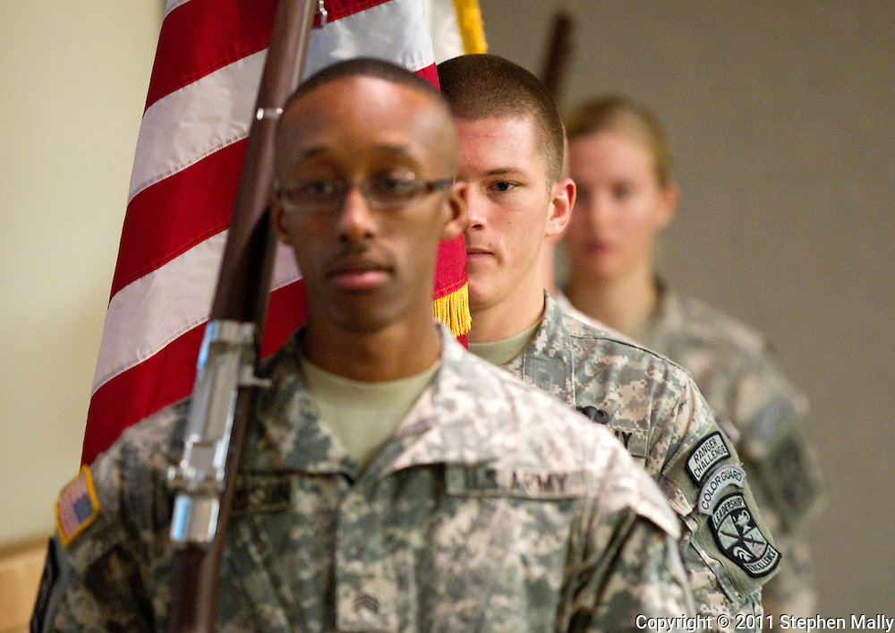 University of Iowa ROTC Color Guard members Marshall Richardson (from left) and Ryan Wilson march up as they post the Colors at the start of the University of Iowa Veterans Reception at the Old Capitol Mall in Iowa City on Wednesday evening, November 9, 2011. (Stephen Mally/Freelance)