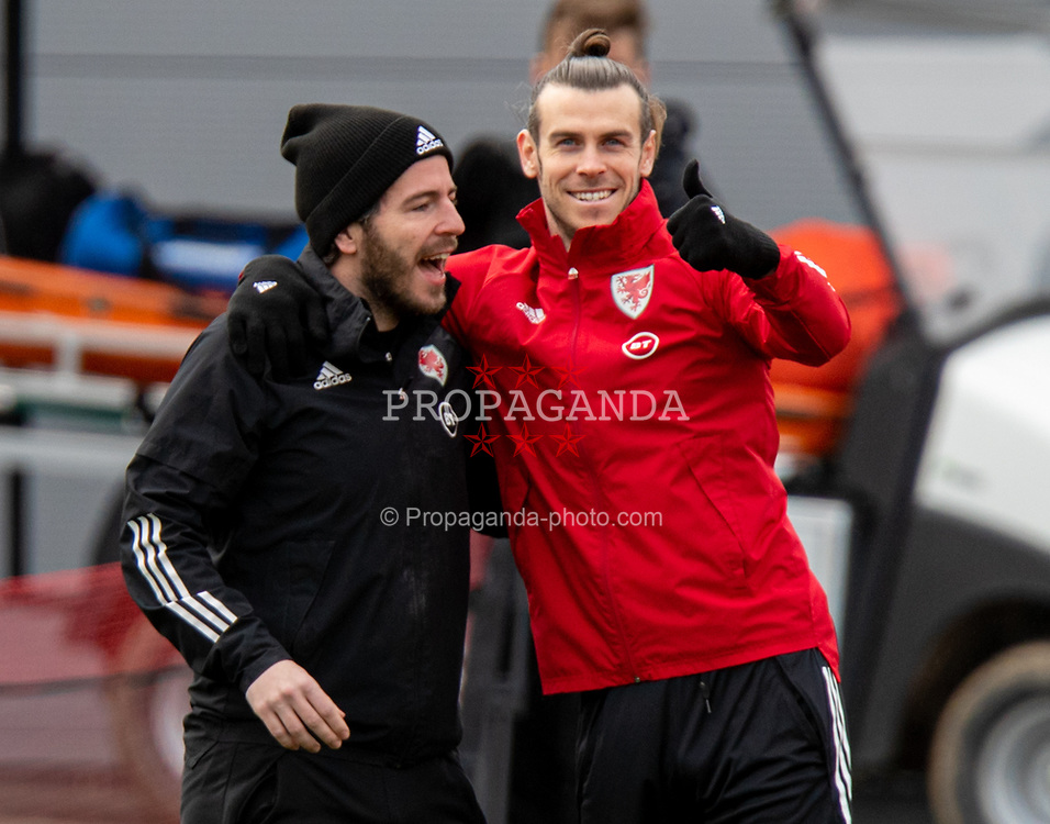 CARDIFF, WALES - Monday, March 29, 2021: Wales' captain Gareth Bale (R) and Ronan Kavanagh during a training session at the Vale Resort ahead of the FIFA World Cup Qatar 2022 Qualifying Group E game against the Czech Republic. (Pic by David Rawcliffe/Propaganda)