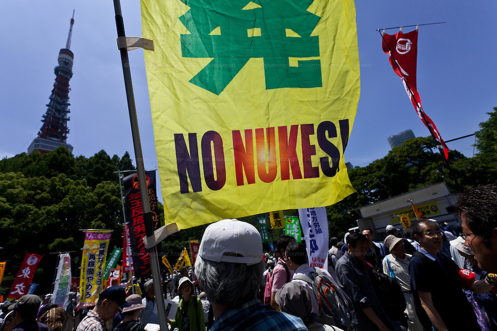 An anti nuclear protester carrying a no nukes flag at a protest in Shiba Park, Minato ward, Tokyo, Japan Sunday June 2nd 2013