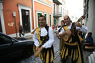 A music group in traditional dress playing as they walk through the streets of  Old San Juan, Puerto Rico