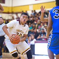 Tohatchi Cougar Jaden Dolfin (32) dribbles between three Navajo Pine Warriors to make a layup during the Tuesday night game in Tohatchi.
