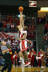 18 January 2009: Wade Knapp beats Dinma Odiakosa to the ball to start the game.  The ball was tossed by official Jim Burr. The Illinois State University Redbirds top the Missouri State Bears 68-56 on Doug Collins Court inside Redbird Arena on the campus of Illinois State University in Normal Illinois