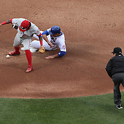 NEW YORK, NEW YORK - APRIL 08: Freddy Galvis, Philadelphia Phillies, drops a potential double play ball as Michael Conforto, New York Mets, slides into second base during the New York Mets Vs Philadelphia Phillies, Mets home opener at Citi Field on April 8, 2016 in New York City. (Photo by Tim Clayton/Corbis via Getty Images)