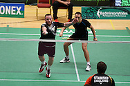 Oliver Gwilt and Nicolas Strange of Wales in mens doubles action.<br /> Wales international badminton championships 2014 at the Welsh institute of Sport, Sophia Gardens in Cardiff, South Wales on Friday 28th November 2014<br /> pic by Andrew Orchard, Andrew Orchard sports photography.