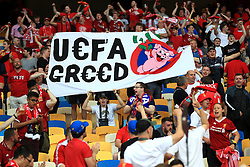 Fans hold up a banner reading 'UEFA Greed' in the stands prior to the UEFA Champions League Final at the NSK Olimpiyskiy Stadium, Kiev.