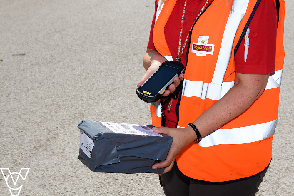 Pictured is a new PDA in use<br /> <br /> The Royal Mail delivery office in Newark have introduced a meet and greet system for postmen returning to the office.<br /> <br /> Date: August 16, 2016