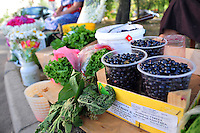 """On sale are """"cherniki,"""" similar to blueberries, at this friendly corner fruit stand opposite the Salt Pier, where river boats moor in St. Petersburg, Russia."""