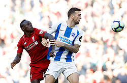 Brighton & Hove Albion's Shane Duffy (right) and Liverpool's Sadio Mane battle for the ball during the Premier League match at Anfield, Liverpool.